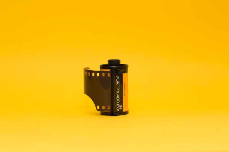 film canister on yellow background